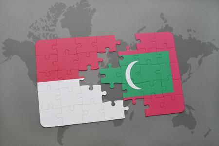 maldives island: puzzle with the national flag of indonesia and maldives on a world map background. 3D illustration