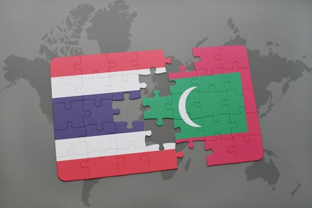 maldives island: puzzle with the national flag of thailand and maldives on a world map background. 3D illustration