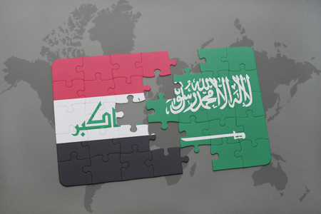 iraq conflict: puzzle with the national flag of iraq and saudi arabia on a world map background. 3D illustration Stock Photo