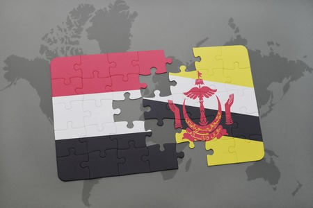 map of brunei: puzzle with the national flag of yemen and brunei on a world map background. 3D illustration