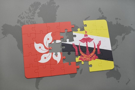 map of brunei: puzzle with the national flag of hong kong and brunei on a world map background. 3D illustration