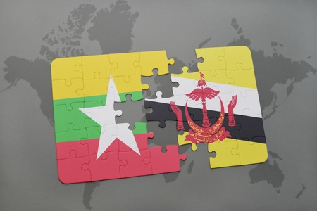 map of brunei: puzzle with the national flag of myanmar and brunei on a world map background. 3D illustration Stock Photo
