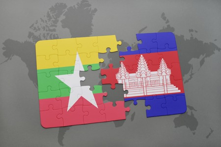 cambodian flag: puzzle with the national flag of myanmar and cambodia on a world map background. 3D illustration