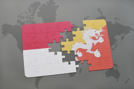 Puzzle with the national flag of myanmar and bhutan on a world puzzle with the national flag of indonesia and bhutan on a world map background 3d gumiabroncs