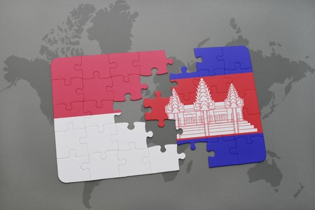 cambodian flag: puzzle with the national flag of indonesia and cambodia on a world map background. 3D illustration