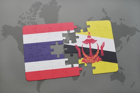map of brunei: puzzle with the national flag of thailand and brunei on a world map background. 3D illustration