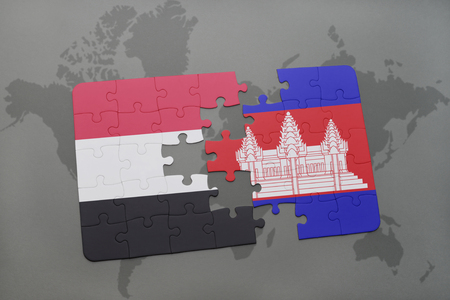 cambodian: puzzle with the national flag of yemen and cambodia on a world map background. 3D illustration Stock Photo