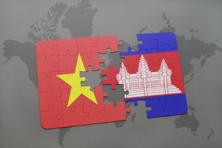 cambodian flag: puzzle with the national flag of vietnam and cambodia on a world map background. 3D illustration Stock Photo