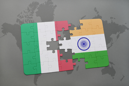 puzzle with the national flag of italy and india on a world map background. 3D illustration Stock Photo