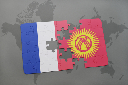puzzle with the national flag of france and kyrgyzstan on a world map background. 3D illustration Stock Photo