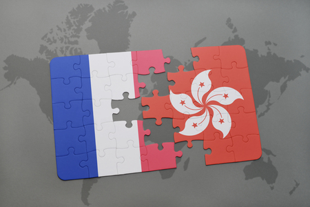 nice france: puzzle with the national flag of france and hong kong on a world map background. 3D illustration