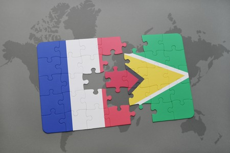 guyanese: puzzle with the national flag of france and guyana on a world map background. 3D illustration Stock Photo