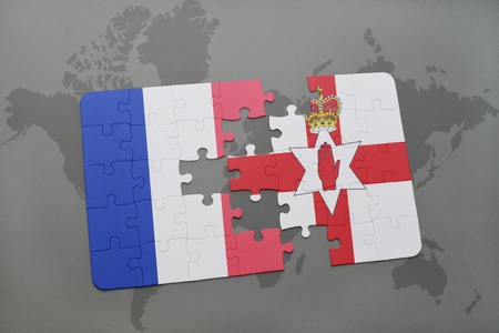 northern ireland: puzzle with the national flag of france and northern ireland on a world map background. 3D illustration