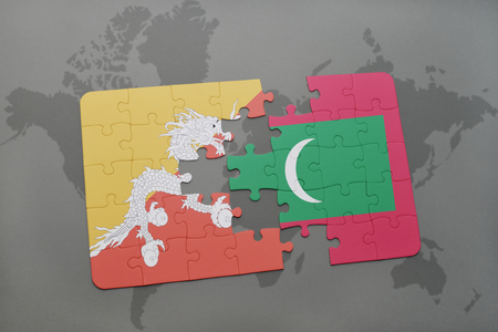 maldives island: puzzle with the national flag of bhutan and maldives on a world map background. 3D illustration