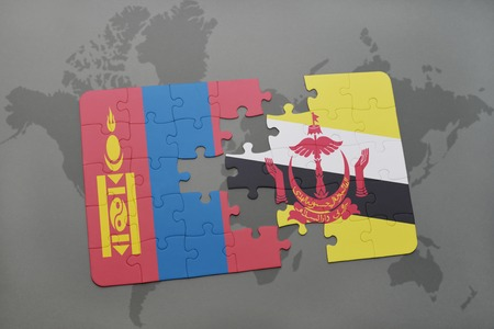 mongolia: puzzle with the national flag of mongolia and brunei on a world map background. 3D illustration
