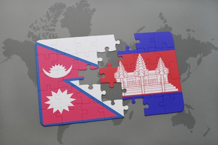 cambodian: puzzle with the national flag of nepal and cambodia on a world map background. 3D illustration Stock Photo