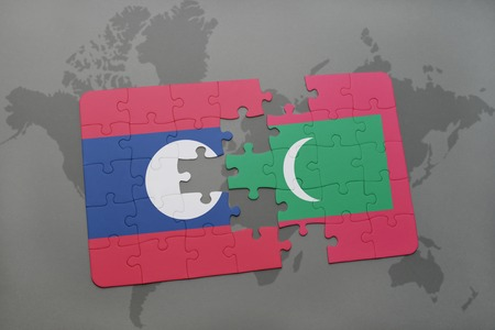 maldives island: puzzle with the national flag of laos and maldives on a world map background. 3D illustration