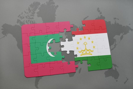 maldives island: puzzle with the national flag of maldives and tajikistan on a world map background. 3D illustration Stock Photo