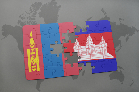 puzzle with the national flag of mongolia and cambodia on a world map background. 3D illustration Stock Photo