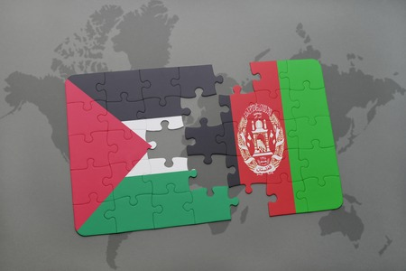 afghan: puzzle with the national flag of palestine and afghanistan on a world map background. 3D illustration