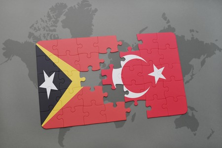timor: puzzle with the national flag of east timor and turkey on a world map background. 3D illustration