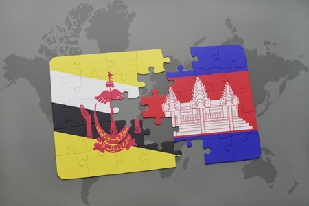 map of brunei: puzzle with the national flag of brunei and cambodia on a world map background. 3D illustration Stock Photo