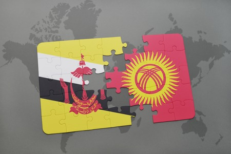 map of brunei: puzzle with the national flag of brunei and kyrgyzstan on a world map background. 3D illustration Stock Photo