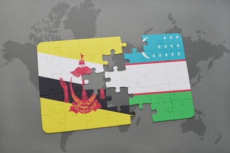 map of brunei: puzzle with the national flag of brunei and uzbekistan on a world map background. 3D illustration Stock Photo