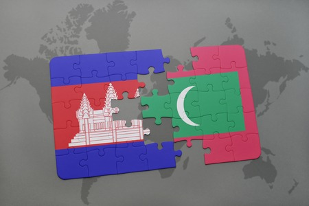 cambodian flag: puzzle with the national flag of cambodia and maldives on a world map background. 3D illustration