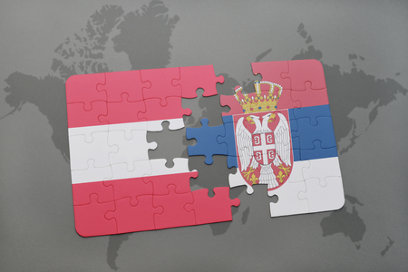 puzzle background: puzzle with the national flag of austria and serbia on a world map background. 3D illustration