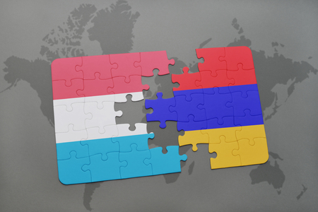 yerevan: puzzle with the national flag of luxembourg and armenia on a world map background. 3D illustration Stock Photo