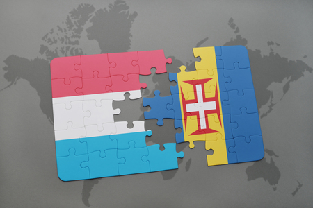 madeira: puzzle with the national flag of luxembourg and madeira on a world map background. 3D illustration