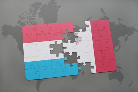 maltese map: puzzle with the national flag of luxembourg and malta on a world map background. 3D illustration Stock Photo