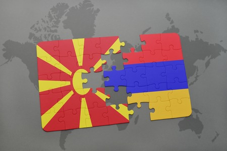 puzzle with the national flag of macedonia and armenia on a world map background. 3D illustration