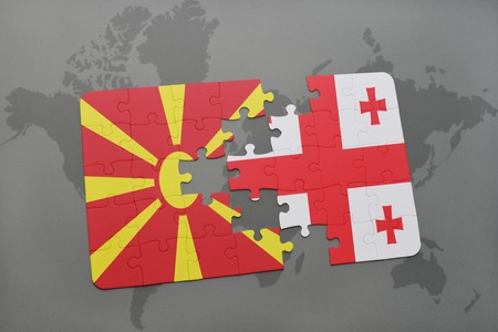 georgian: puzzle with the national flag of macedonia and georgia on a world map background. 3D illustration Stock Photo