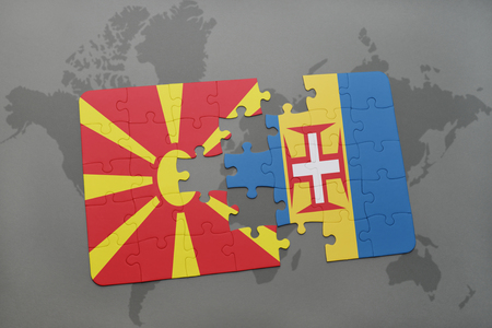madeira: puzzle with the national flag of macedonia and madeira on a world map background. 3D illustration Stock Photo
