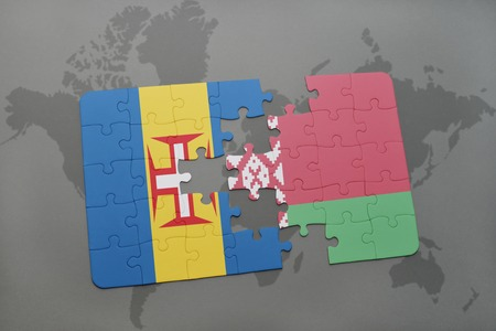 madeira: puzzle with the national flag of madeira and belarus on a world map background. 3D illustration Stock Photo