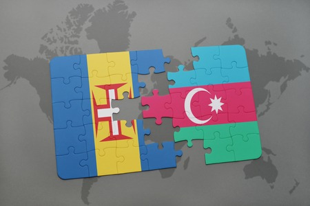 madeira: puzzle with the national flag of madeira and azerbaijan on a world map background. 3D illustration Stock Photo
