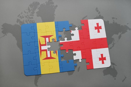 madeira: puzzle with the national flag of madeira and georgia on a world map background. 3D illustration