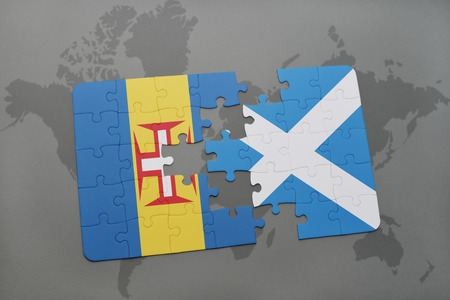 puzzle with the national flag of madeira and scotland on a world map background. 3D illustration