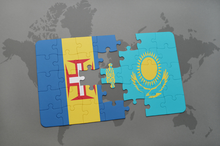 madeira: puzzle with the national flag of madeira and kazakhstan on a world map background. 3D illustration Stock Photo