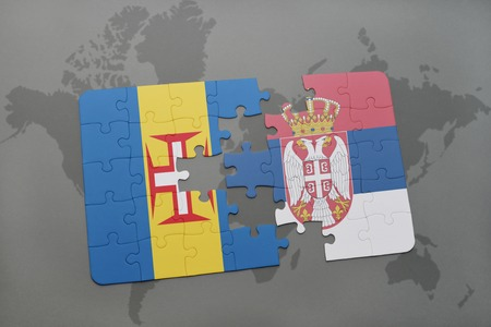 puzzle with the national flag of madeira and serbia on a world map background. 3D illustration