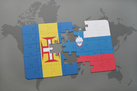madeira: puzzle with the national flag of madeira and slovenia on a world map background. 3D illustration Stock Photo