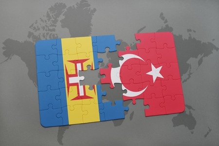 puzzle with the national flag of madeira and turkey on a world map background. 3D illustration Stock Photo