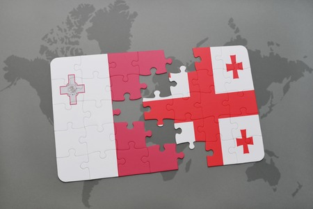 maltese map: puzzle with the national flag of malta and georgia on a world map background. 3D illustration