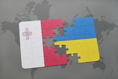 puzzle with the national flag of malta and ukraine on a world map background. 3D illustration