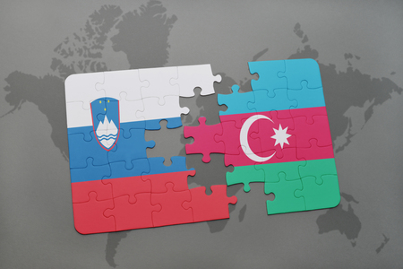 slovenian: puzzle with the national flag of slovenia and azerbaijan on a world map background. 3D illustration Stock Photo
