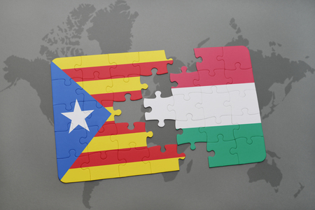 catalonia: puzzle with the national flag of catalonia and hungary on a world map background. 3D illustration Stock Photo