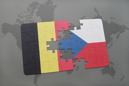 czech: puzzle with the national flag of belgium and czech republic on a world map background. 3D illustration Stock Photo