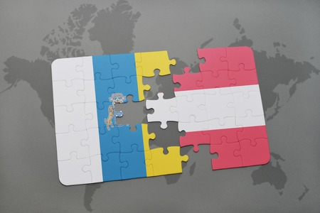 canary: puzzle with the national flag of canary islands and austria on a world map background. 3D illustration Stock Photo
